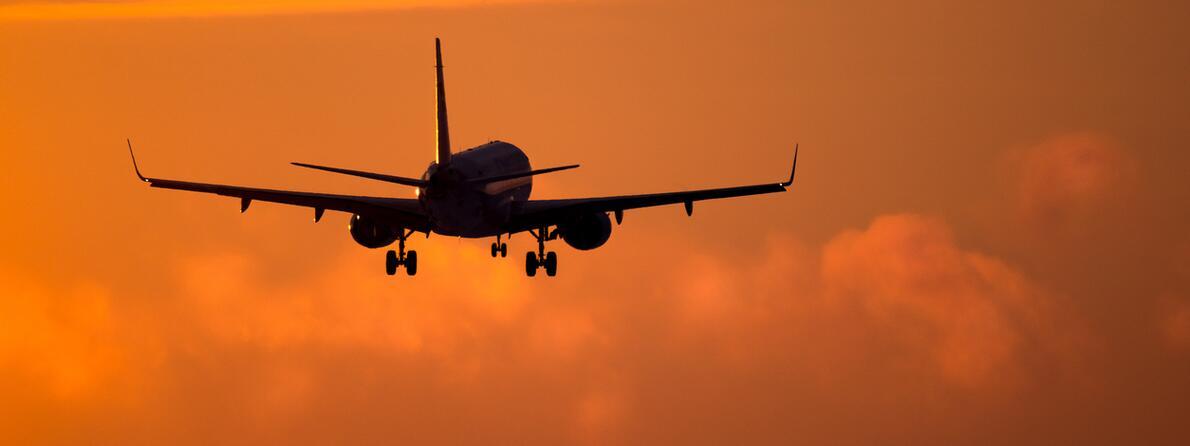 iStock-505754522 plane in sunset
